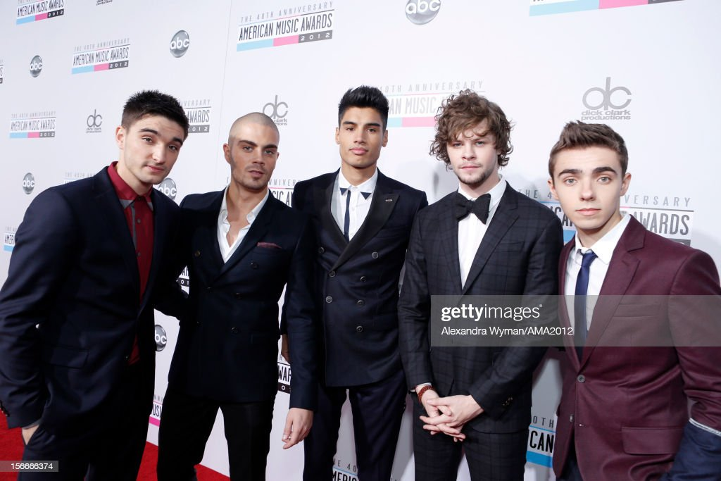 Singers Tom Parker, <a gi-track='captionPersonalityLinkClicked' href=/galleries/search?phrase=Max+George&family=editorial&specificpeople=7039808 ng-click='$event.stopPropagation()'>Max George</a>, <a gi-track='captionPersonalityLinkClicked' href=/galleries/search?phrase=Siva+Kaneswaran&family=editorial&specificpeople=7039810 ng-click='$event.stopPropagation()'>Siva Kaneswaran</a>, <a gi-track='captionPersonalityLinkClicked' href=/galleries/search?phrase=Jay+McGuiness&family=editorial&specificpeople=7039806 ng-click='$event.stopPropagation()'>Jay McGuiness</a>, and <a gi-track='captionPersonalityLinkClicked' href=/galleries/search?phrase=Nathan+Sykes&family=editorial&specificpeople=7039809 ng-click='$event.stopPropagation()'>Nathan Sykes</a> of The Wanted attend the 40th American Music Awards held at Nokia Theatre L.A. Live on November 18, 2012 in Los Angeles, California.