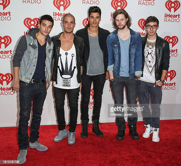 Singers Tom Parker Max George Siva Kaneswaran Jay McGuiness and Nathan Sykes of The Wanted pose in the iHeartRadio music festival photo room on...