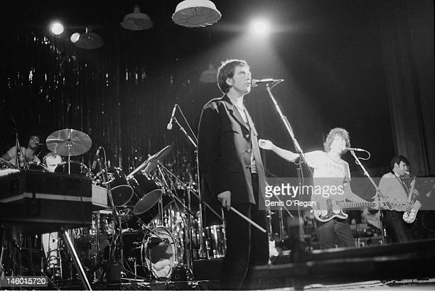 Singers Tom Robinson and Peter Gabriel performing at the Hammersmith Odeon in London during the Rob Gab Xmas charity show 24th December 1978 Andy...