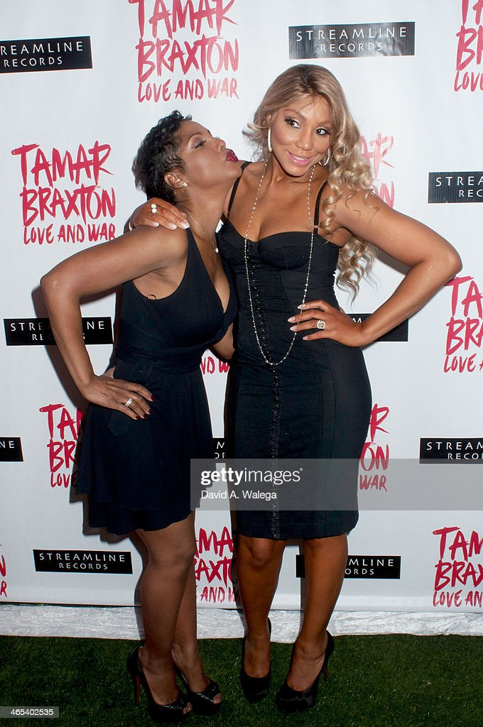 Singers Toni Braxton (L) and sister Tamar Braxton (R) arrive at Xen Lounge for a Night To Celebrate Tamar Braxton's GRAMMY Nominations on January 26, 2014 in Los Angeles, California.