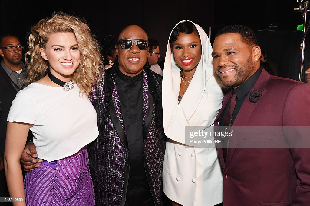 Singers <a gi-track='captionPersonalityLinkClicked' href=/galleries/search?phrase=Tori+Kelly&family=editorial&specificpeople=7495626 ng-click='$event.stopPropagation()'>Tori Kelly</a>, <a gi-track='captionPersonalityLinkClicked' href=/galleries/search?phrase=Stevie+Wonder&family=editorial&specificpeople=171911 ng-click='$event.stopPropagation()'>Stevie Wonder</a> and <a gi-track='captionPersonalityLinkClicked' href=/galleries/search?phrase=Jennifer+Hudson&family=editorial&specificpeople=234833 ng-click='$event.stopPropagation()'>Jennifer Hudson</a>, with host <a gi-track='captionPersonalityLinkClicked' href=/galleries/search?phrase=Anthony+Anderson&family=editorial&specificpeople=202577 ng-click='$event.stopPropagation()'>Anthony Anderson</a>, attend the 2016 BET Awards at the Microsoft Theater on June 26, 2016 in Los Angeles, California.
