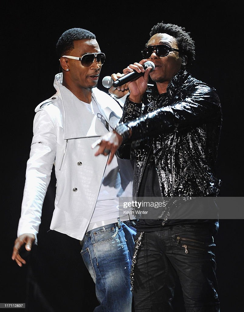 Singers <a gi-track='captionPersonalityLinkClicked' href=/galleries/search?phrase=Trey+Songz&family=editorial&specificpeople=674835 ng-click='$event.stopPropagation()'>Trey Songz</a> (L) and <a gi-track='captionPersonalityLinkClicked' href=/galleries/search?phrase=Lupe+Fiasco&family=editorial&specificpeople=540344 ng-click='$event.stopPropagation()'>Lupe Fiasco</a> perform onstage during the 2011 MTV Movie Awards at Universal Studios' Gibson Amphitheatre on June 5, 2011 in Universal City, California.