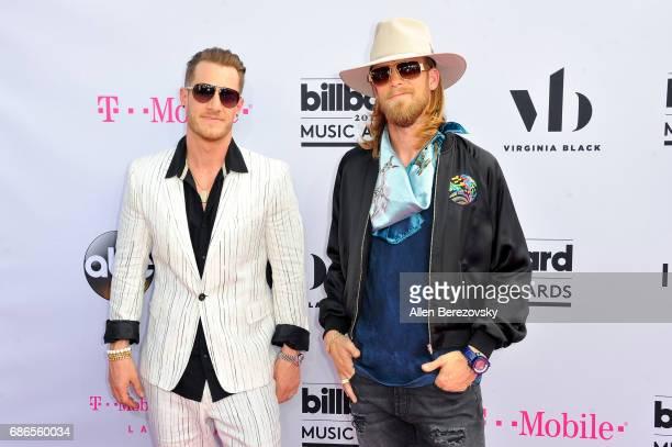 Singers Tyler Hubbard and Brian Kelley of Florida Georgia Line arrive at 2017 Billboard Music Awards at TMobile Arena on May 21 2017 in Las Vegas...