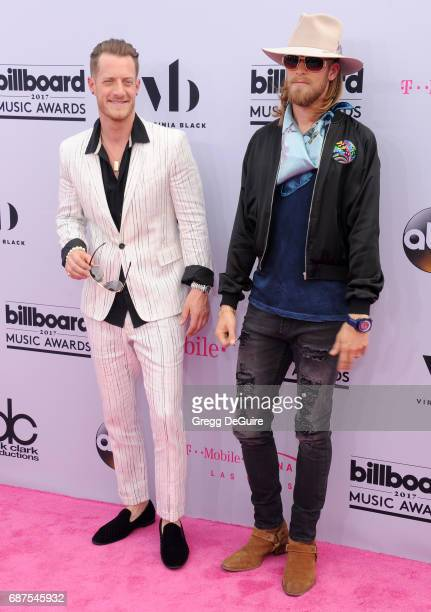 Singers Tyler Hubbard and Brian Kelley of Florida Georgia Line arrive at the 2017 Billboard Music Awards at TMobile Arena on May 21 2017 in Las Vegas...