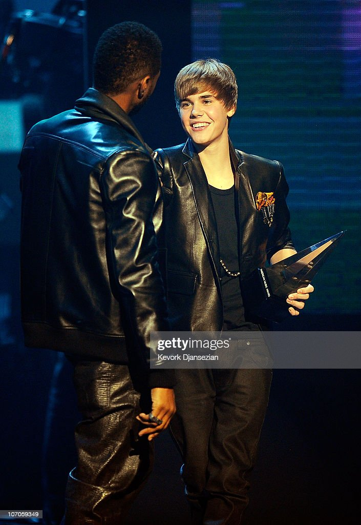 Singers Usher and Artist of the Years award winner <a gi-track='captionPersonalityLinkClicked' href=/galleries/search?phrase=Justin+Bieber&family=editorial&specificpeople=5780923 ng-click='$event.stopPropagation()'>Justin Bieber</a> onstage during the 2010 American Music Awards held at Nokia Theatre L.A. Live on November 21, 2010 in Los Angeles, California.