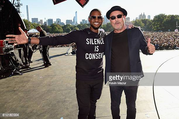 Singers Usher and Ruben Blades pose onstage at the 2016 Global Citizen Festival In Central Park To End Extreme Poverty By 2030 at Central Park on...