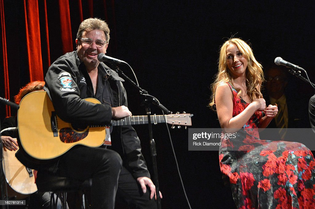 Singers <a gi-track='captionPersonalityLinkClicked' href=/galleries/search?phrase=Vince+Gill&family=editorial&specificpeople=215309 ng-click='$event.stopPropagation()'>Vince Gill</a> and Ashley Monroe perform during the All For the Hall New York concert benefiting the Country Music Hall of Fame at Best Buy Theater on February 26, 2013 in New York City.