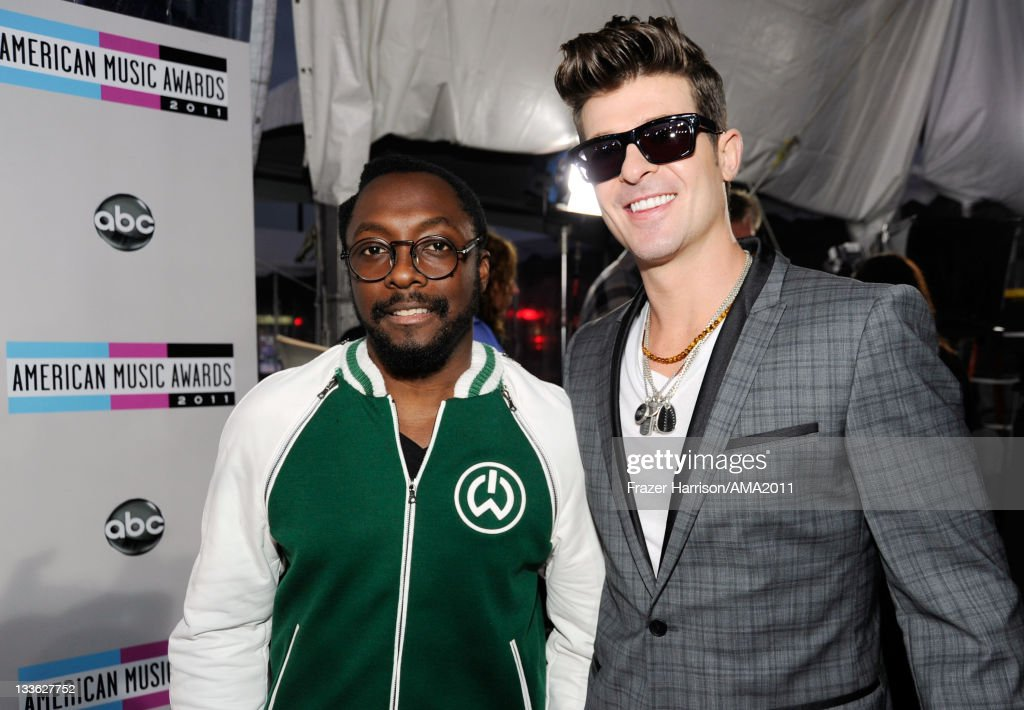 Singers will.i.am and <a gi-track='captionPersonalityLinkClicked' href=/galleries/search?phrase=Robin+Thicke&family=editorial&specificpeople=724390 ng-click='$event.stopPropagation()'>Robin Thicke</a> arrive at the 2011 American Music Awards held at Nokia Theatre L.A. LIVE on November 20, 2011 in Los Angeles, California.