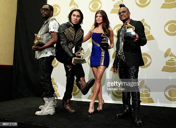 Singers william Taboo Fergie and apldeap of the music group the Black Eyed Peas pose in the press room at the 52nd Annual GRAMMY Awards held at...