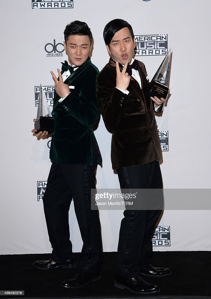 Singers Xiao Yang (L) and Wang Taili of the Chopstick Brothers pose in the press room at the 2014 American Music Awards at Nokia Theatre L.A. Live on November 23, 2014 in Los Angeles, California.
