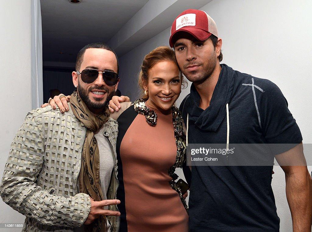 Singers Yandel of musical group Wisin Y Yandel Jennifer Lopez and Enrique Iglesias pose backstage at a press conference at Boulevard3 on April 30...