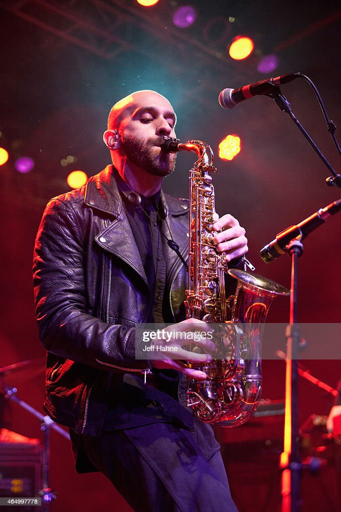 Singer/saxophonist Sam Harris of X Ambassadors performs at The Fillmore Charlotte on March 2 2015 in Charlotte North Carolina
