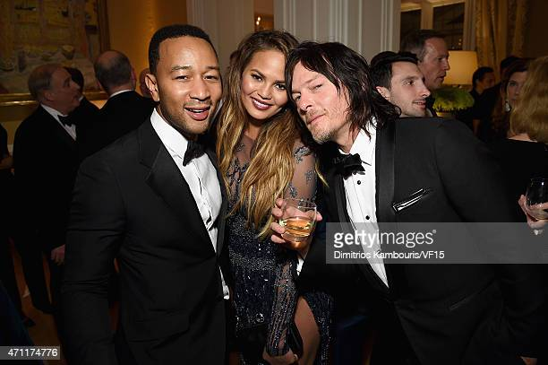 Singer/singwriter John Legend model Chrissy Teigen and Norman Reedus attend the Bloomberg Vanity Fair cocktail reception following the 2015 WHCA...