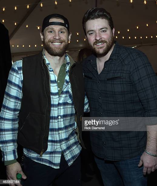 Singer/Songer Chase Rice and Singer/Songwriter Chris Young attend the 2015 Sports Illustrated Swimsuit's 'Swimville' Takes Over Nashville Day 2 on...