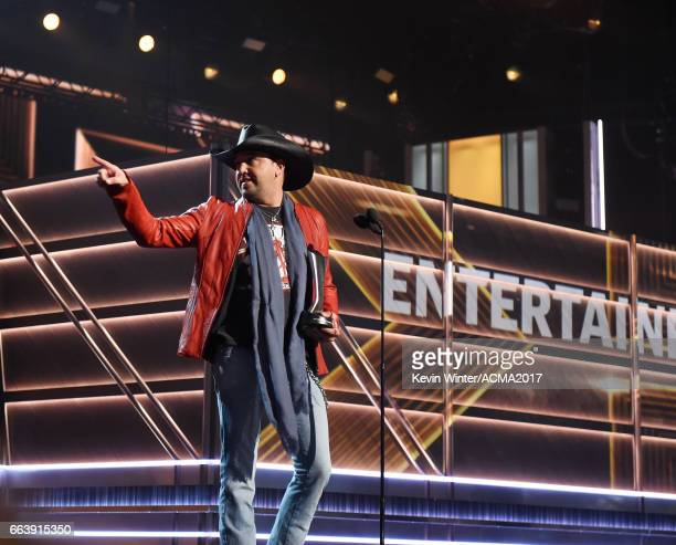 Singersongriter Jason Aldean accepts the Entertainer of the Year award onstage during the 52nd Academy of Country Music Awards at TMobile Arena on...