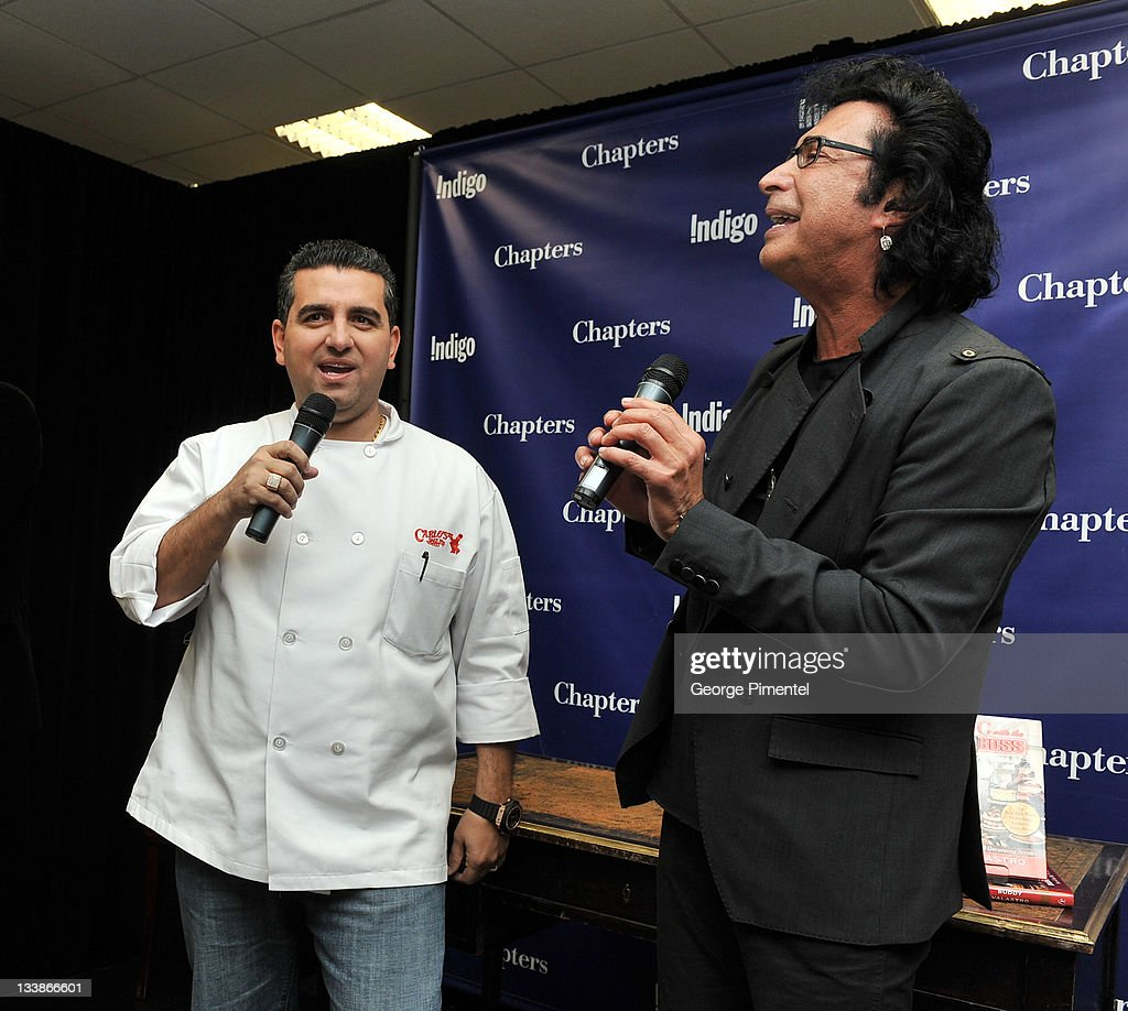 Singer/songwrite Andy Kim (R) serenades 'Cake Boss' Star <a gi-track='captionPersonalityLinkClicked' href=/galleries/search?phrase=Buddy+Valastro&family=editorial&specificpeople=5810322 ng-click='$event.stopPropagation()'>Buddy Valastro</a> with the song 'Sugar, Sugar' as <a gi-track='captionPersonalityLinkClicked' href=/galleries/search?phrase=Buddy+Valastro&family=editorial&specificpeople=5810322 ng-click='$event.stopPropagation()'>Buddy Valastro</a> promotes his new book 'Baking with the Cake Boss: 100 of Buddy's Best Recipes and Decorating Secrets' at Indigo Manulife Centre on November 21, 2011 in Toronto, Canada.