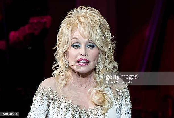 Singersongwriter actress author businesswoman Dolly Parton performs during Dolly Parton Pure Simple Tour at Mann Center For Performing Arts on June...