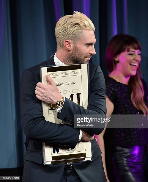 Singersongwriter Adam Levine of Maroon 5 accepts the 2014 BMI Songwriter of the Year Award onstage at the 62nd annual BMI Pop Awards at the Regent...