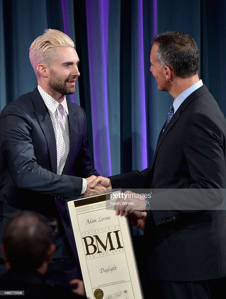 Singer-songwriter Adam Levine of Maroon 5 accepts the 2014 BMI Songwriter of the Year Award from Michael O'Neill, BMI CEO onstage at the 62nd annual BMI Pop Awards at the Regent Beverly Wilshire Hotel on May 13, 2014 in Beverly Hills, California.