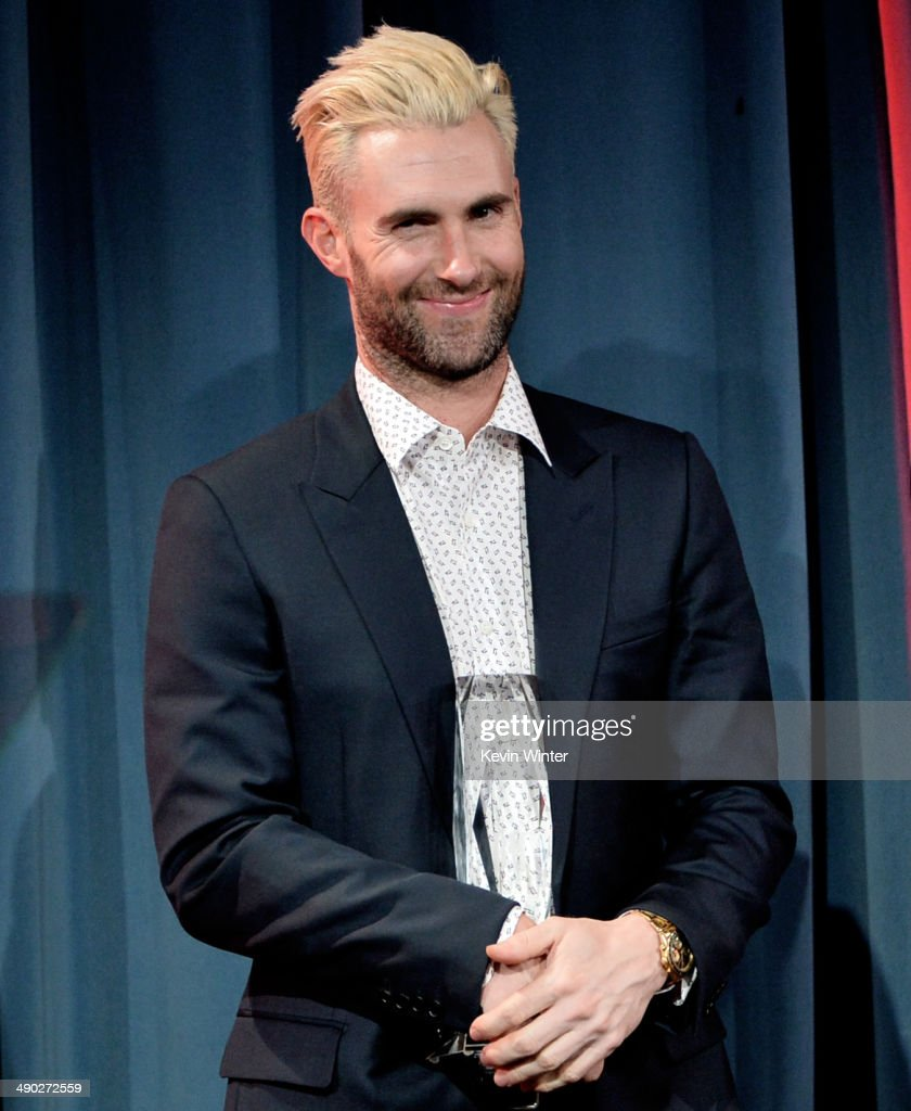 Singer-songwriter <a gi-track='captionPersonalityLinkClicked' href=/galleries/search?phrase=Adam+Levine+-+Singer&family=editorial&specificpeople=202962 ng-click='$event.stopPropagation()'>Adam Levine</a> of Maroon 5 accepts the 2014 BMI Songwriter of the Year Award onstage at the 62nd annual BMI Pop Awards at the Regent Beverly Wilshire Hotel on May 13, 2014 in Beverly Hills, California.
