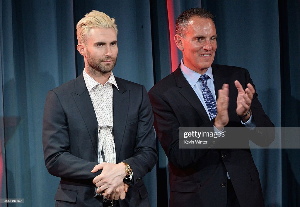 Singer-songwriter Adam Levine of Maroon 5 (L) accepts the 2014 BMI Songwriter of the Year Award from Michael O'Neill, BMI CEO onstage at the 62nd annual BMI Pop Awards at the Regent Beverly Wilshire Hotel on May 13, 2014 in Beverly Hills, California.