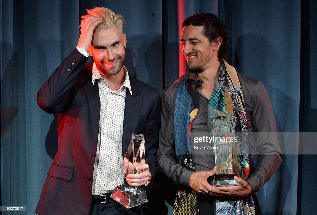 Singer-songwriter Adam Levine of Maroon 5 (L) and producer/songwriter Jeff Bhasker accept the 2014 BMI Songwriter of the Year Award onstage at the 62nd annual BMI Pop Awards at the Regent Beverly Wilshire Hotel on May 13, 2014 in Beverly Hills, California.