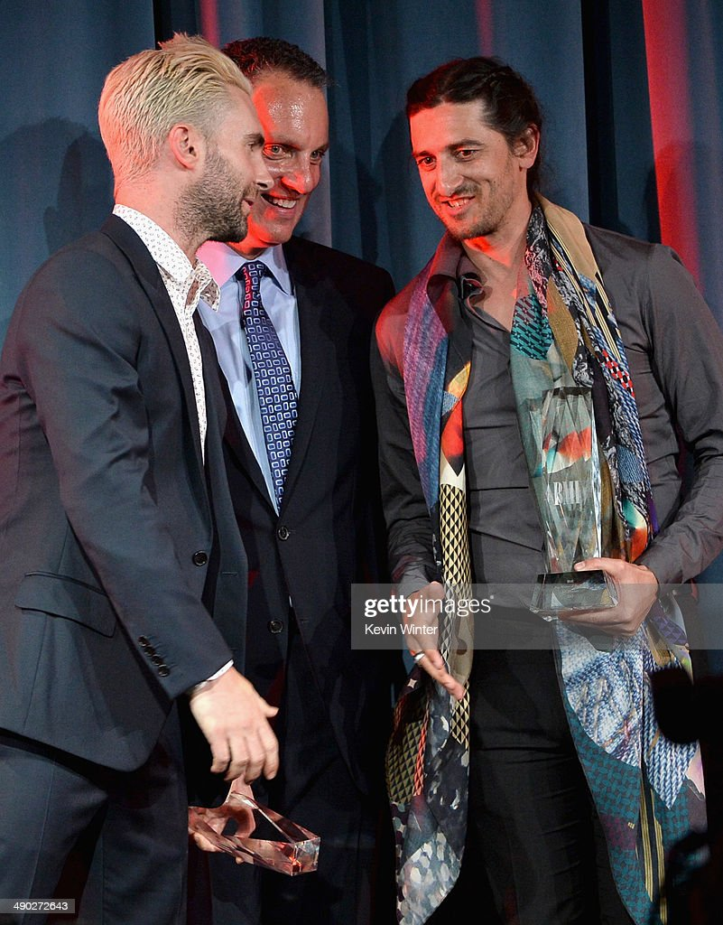 Singer-songwriter Adam Levine of Maroon 5 and producer/songwriter Jeff Bhasker accept the 2014 BMI Songwriter of the Year Award from Michael O'Neill, BMI CEO (center) onstage at the 62nd annual BMI Pop Awards at the Regent Beverly Wilshire Hotel on May 13, 2014 in Beverly Hills, California.