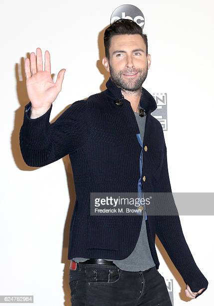 Singersongwriter Adam Levine of musical group Maroon 5 poses in the press room during the 2016 American Music Awards at Microsoft Theater on November...