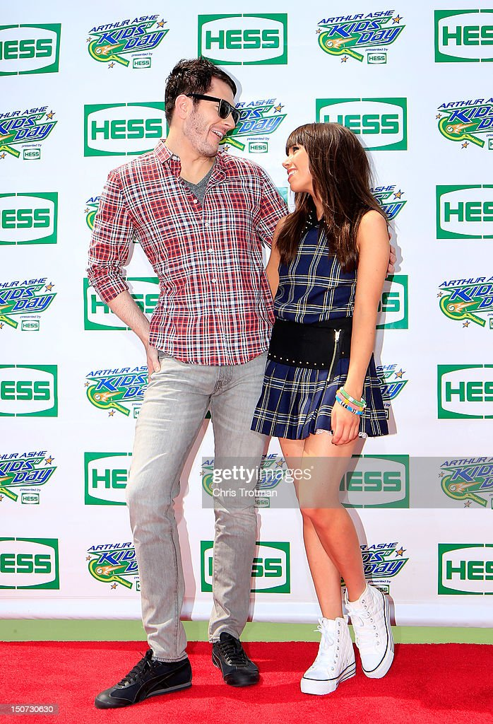 Singer-songwriter Adam Young of Owl City and recording artist Carly Rae Jepsen pose on the red carpet before performing at Arthur Ashe Kids' Day prior to the start of the 2012 U.S. Open at the USTA Billie Jean King National Tennis Center on August 25, 2012 in the Flushing neighborhood, of the Queens borough of New York City.
