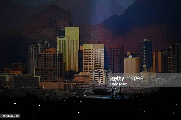 Singer/songwriter Adele performs with an image of the city of Phoenix behind her at Talking Stick Resort Arena on August 16 2016 in Phoenix Arizona