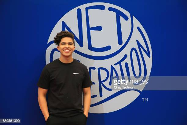 Singer/Songwriter Alex Aiono stands on the red carpet before the stadium show during Arthur Ashe Kids' Day prior to the start of the 2017 US Open at...