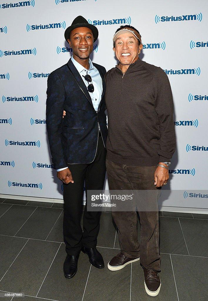 Singer/songwriter Aloe Blacc (L) and singer/songwriter Smokey Robinson visit SiriusXM Studios on October 1, 2014 in New York City.