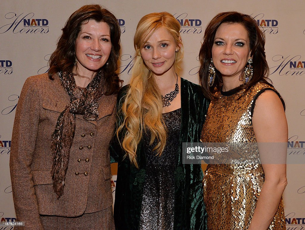 Singer/Songwriter <a gi-track='captionPersonalityLinkClicked' href=/galleries/search?phrase=Amy+Grant&family=editorial&specificpeople=240521 ng-click='$event.stopPropagation()'>Amy Grant</a>, ABC TV's ' Nashville' Singer/Songwriter <a gi-track='captionPersonalityLinkClicked' href=/galleries/search?phrase=Clare+Bowen&family=editorial&specificpeople=5711319 ng-click='$event.stopPropagation()'>Clare Bowen</a> With Honoree Singer/Songwriter <a gi-track='captionPersonalityLinkClicked' href=/galleries/search?phrase=Martina+McBride&family=editorial&specificpeople=204772 ng-click='$event.stopPropagation()'>Martina McBride</a> attend the 3rd. annual NATD Honors 2013 at the Hermitage Hotel on November 12, 2013 in Nashville, Tennessee.
