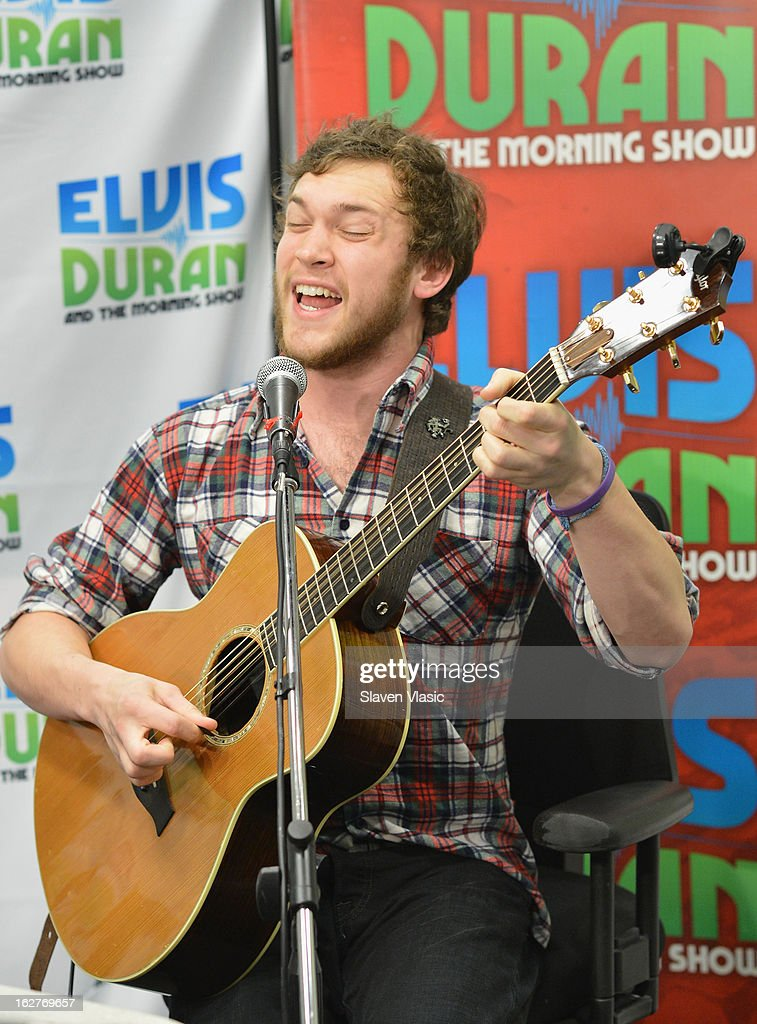 Singer/songwriter and American Idol's 11th season winner <a gi-track='captionPersonalityLinkClicked' href=/galleries/search?phrase=Phillip+Phillips&family=editorial&specificpeople=1651494 ng-click='$event.stopPropagation()'>Phillip Phillips</a> performs at Elvis Duran Z100 Morning Show at Z100 Studio on February 26, 2013 in New York City.