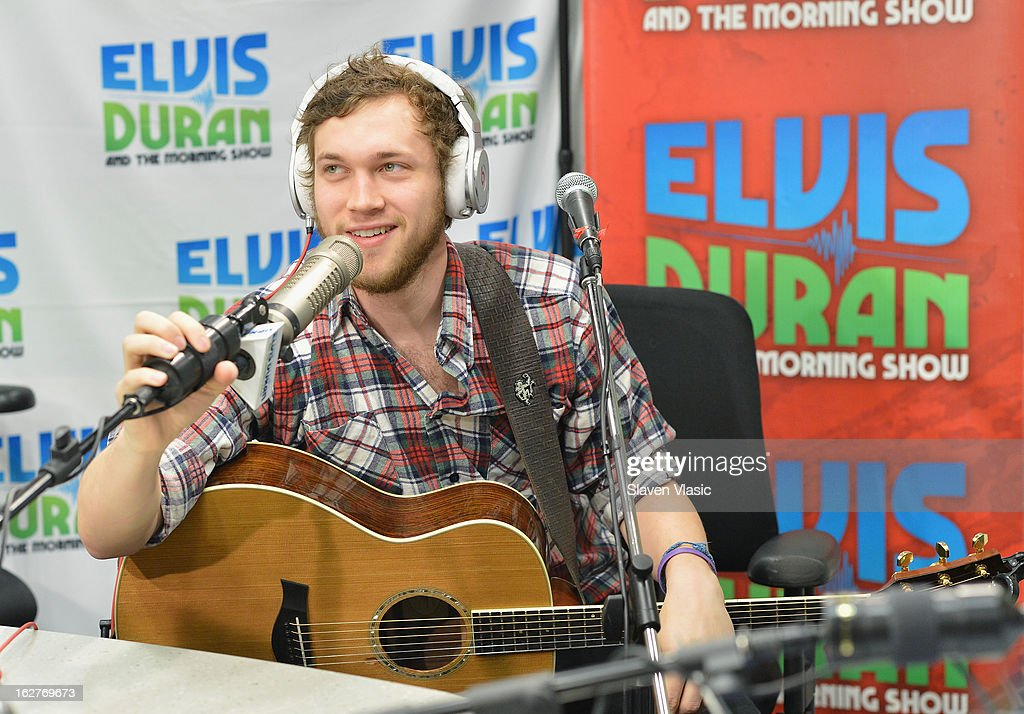 Singer/songwriter and American Idol's 11th season winner <a gi-track='captionPersonalityLinkClicked' href=/galleries/search?phrase=Phillip+Phillips&family=editorial&specificpeople=1651494 ng-click='$event.stopPropagation()'>Phillip Phillips</a> visits Elvis Duran Z100 Morning Show at Z100 Studio on February 26, 2013 in New York City.