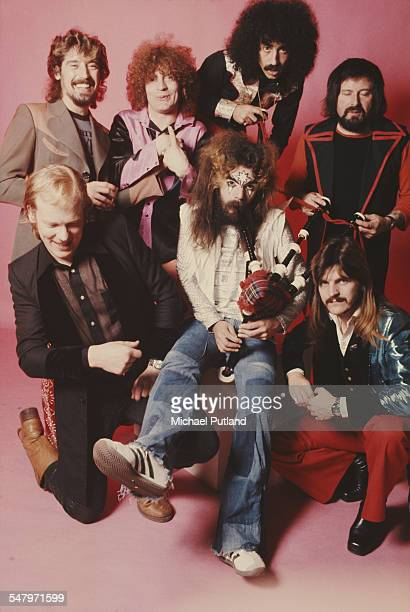 Singersongwriter and musician Roy Wood plays the bagpipes surrounded by the other members of English pop group Wizzard London 6th December 1974...