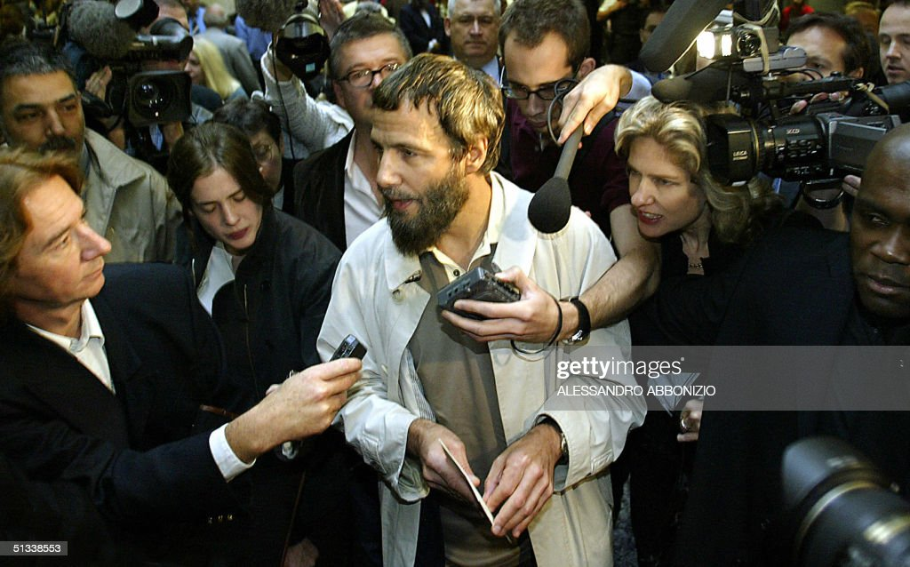 Singer-songwriter and peace activist Yusuf Islam, formerly known as Cat Stevens speaks to journalists at London's Heathrow airport after being refused entry into the United States, 23 September, 2004. Islam, 57, was travelling to the US capital on Tuesday when his flight was diverted to Bangor, Maine where he was detained on 'national security grounds,' according to a US security official.