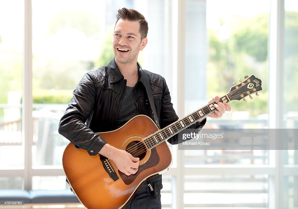 Singer-Songwriter <a gi-track='captionPersonalityLinkClicked' href=/galleries/search?phrase=Andy+Grammer&family=editorial&specificpeople=7469992 ng-click='$event.stopPropagation()'>Andy Grammer</a> gives a surprise performance at a cancer center in LA in partnership with Ford Warriors in Pink at Providence Saint John's Health Center on April 22, 2015 in Santa Monica, California.