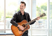 SingerSongwriter Andy Grammer gives a surprise performance at a cancer center in LA in partnership with Ford Warriors in Pink at Providence Saint...