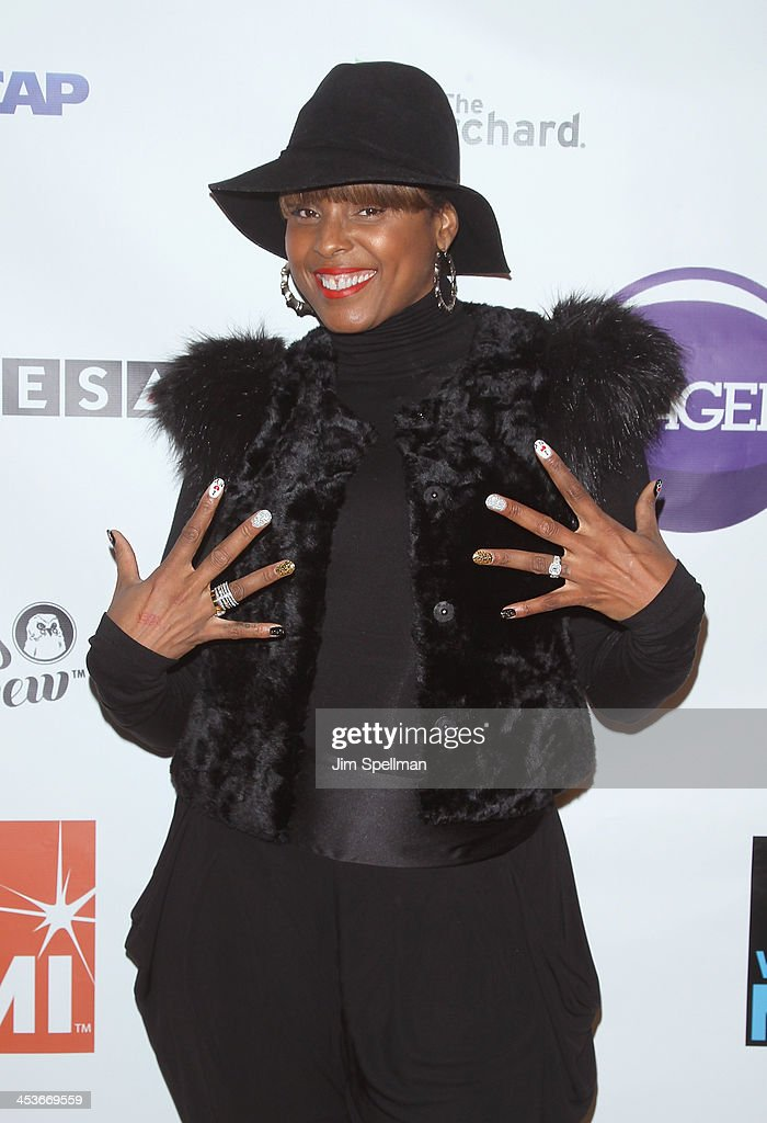 Singer/songwriter <a gi-track='captionPersonalityLinkClicked' href=/galleries/search?phrase=Angela+Hunte&family=editorial&specificpeople=6716527 ng-click='$event.stopPropagation()'>Angela Hunte</a> attends the Women In Music presents their 2013 holiday party at Le Poisson Rouge on December 4, 2013 in New York City.