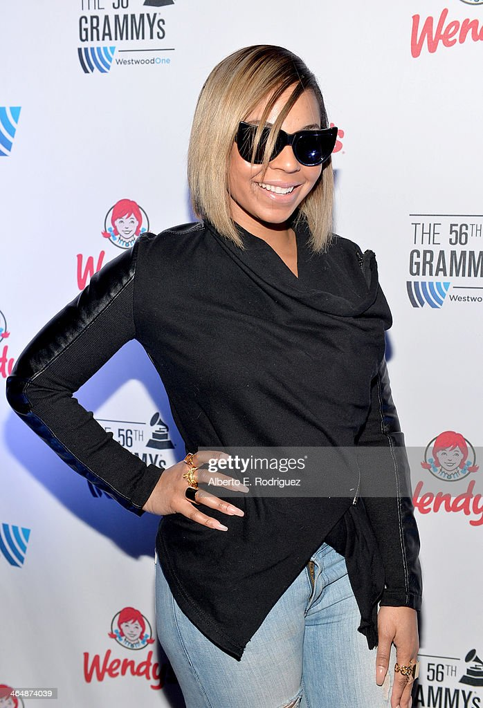 Singersongwriter Ashanti posess backstage at the GRAMMYs Westwood One Radio Remotes during the 56th GRAMMY Awards at the Staples Center Arena Club on...