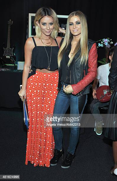 Singersongwriter Aubrey O'Day of Danity Kane and Model Carmen Electra attend day 2 of the 2013 American Music Awards gift lounge at Nokia Theatre LA...