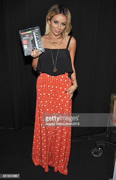 Singersongwriter Aubrey O'Day of Danity Kane attends day 2 of the 2013 American Music Awards gift lounge at Nokia Theatre LA Live on November 23 2013...