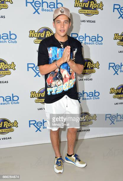 Singer/songwriter Austin Mahone arrives at the Rehab Beach Club pool party to celebrate his 21st birthday at the Hard Rock Hotel Casino on April 8...