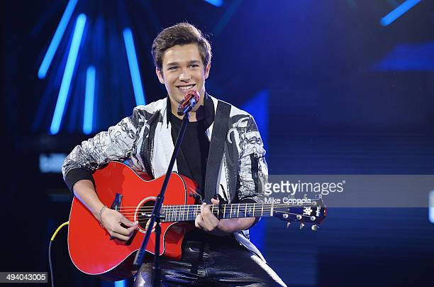 Singer/songwriter Austin Mahone performs at the Billboard Twitter RealTime Charts Launch at The Diamond Horseshoe on May 27 2014 in New York City