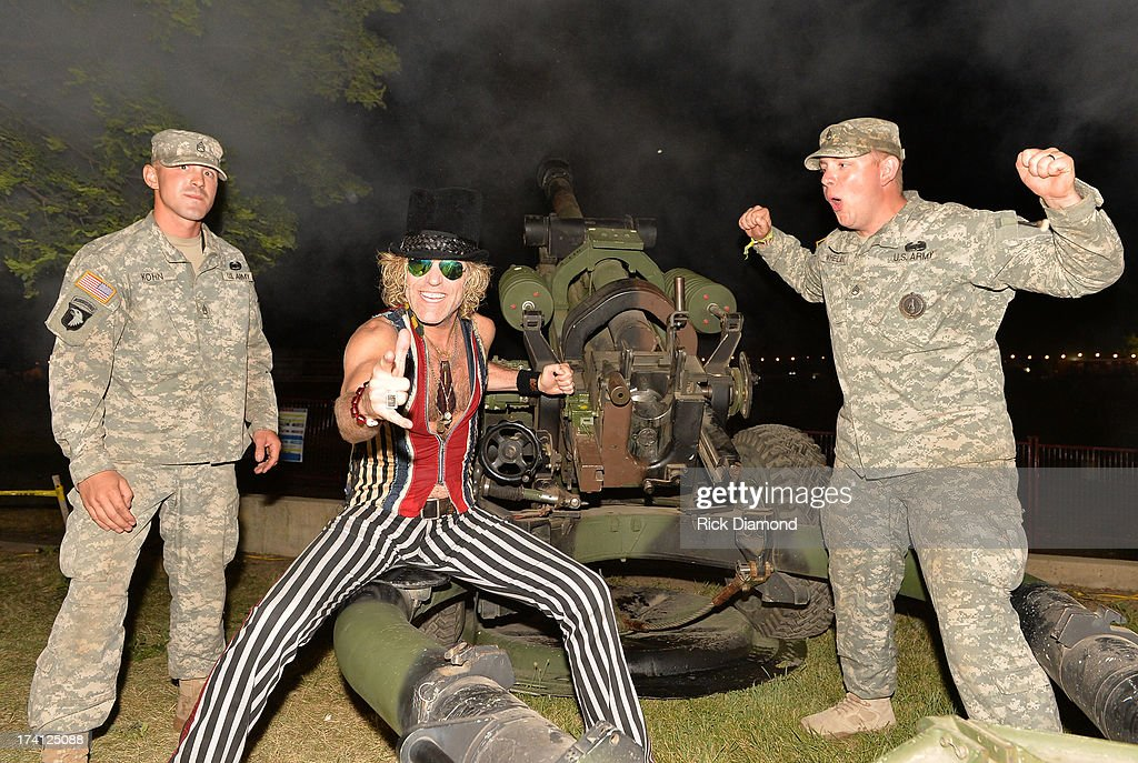 Singer/Songwriter Big Kenny fires a Howitzer 105mm cannon with members of the Wisconsin National Guard at Country Thunder - Twin Lakes, Wisconsin - Day 2 on July 19, 2013 in Twin Lakes, Wisconsin.