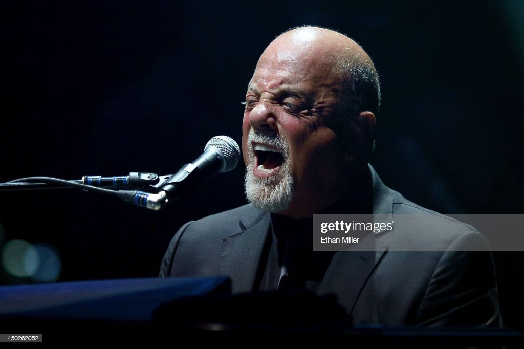 Singer/songwriter <a gi-track='captionPersonalityLinkClicked' href=/galleries/search?phrase=Billy+Joel&family=editorial&specificpeople=203097 ng-click='$event.stopPropagation()'>Billy Joel</a> performs at the MGM Grand Garden Arena on June 7, 2014 in Las Vegas, Nevada.
