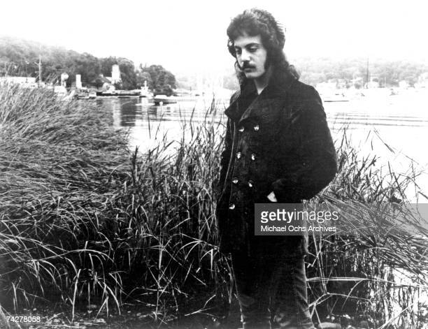 Singer/songwriter Billy Joel poses for a portait by a river bank in circa 1971