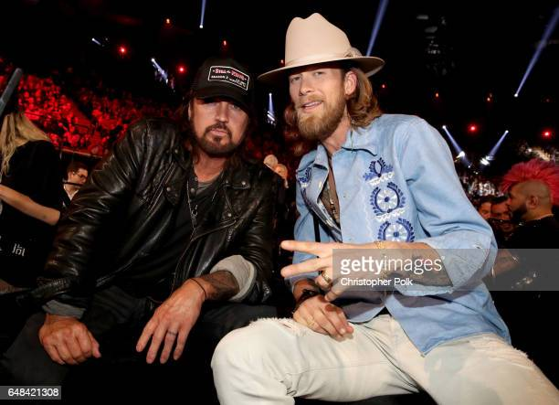 Singersongwriter Billy Ray Cyrus and singersongwriter Brian Kelley of music group Florida Georgia Line pose during the 2017 iHeartRadio Music Awards...