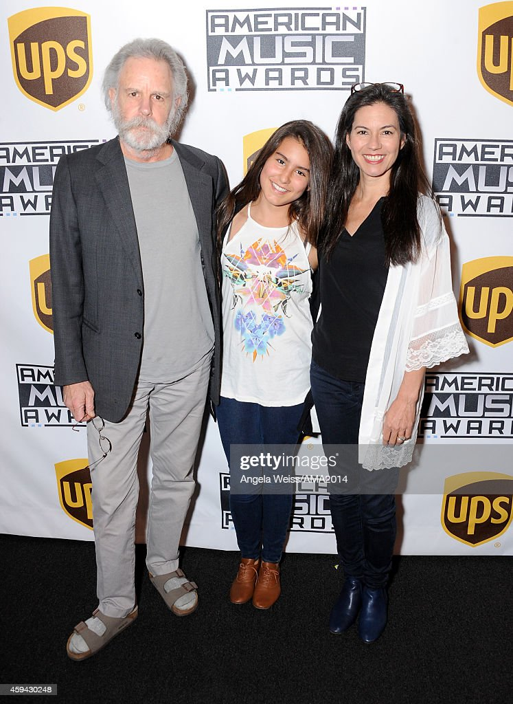 Singer/songwriter Bob Weir, Chloe Kaelia Weir, and Natascha Munter attends the 2014 American Music Awards UPS Gifting Suite at Nokia Theatre L.A. Live on November 22, 2014 in Los Angeles, California.
